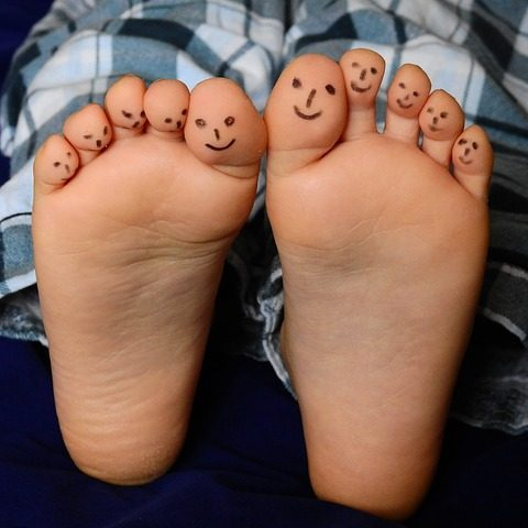 10 toes with smiles drawn