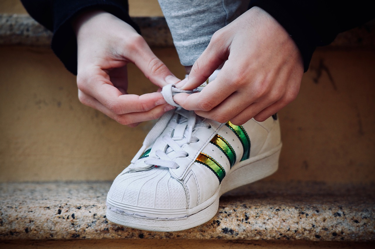 fingers tying shoelaces